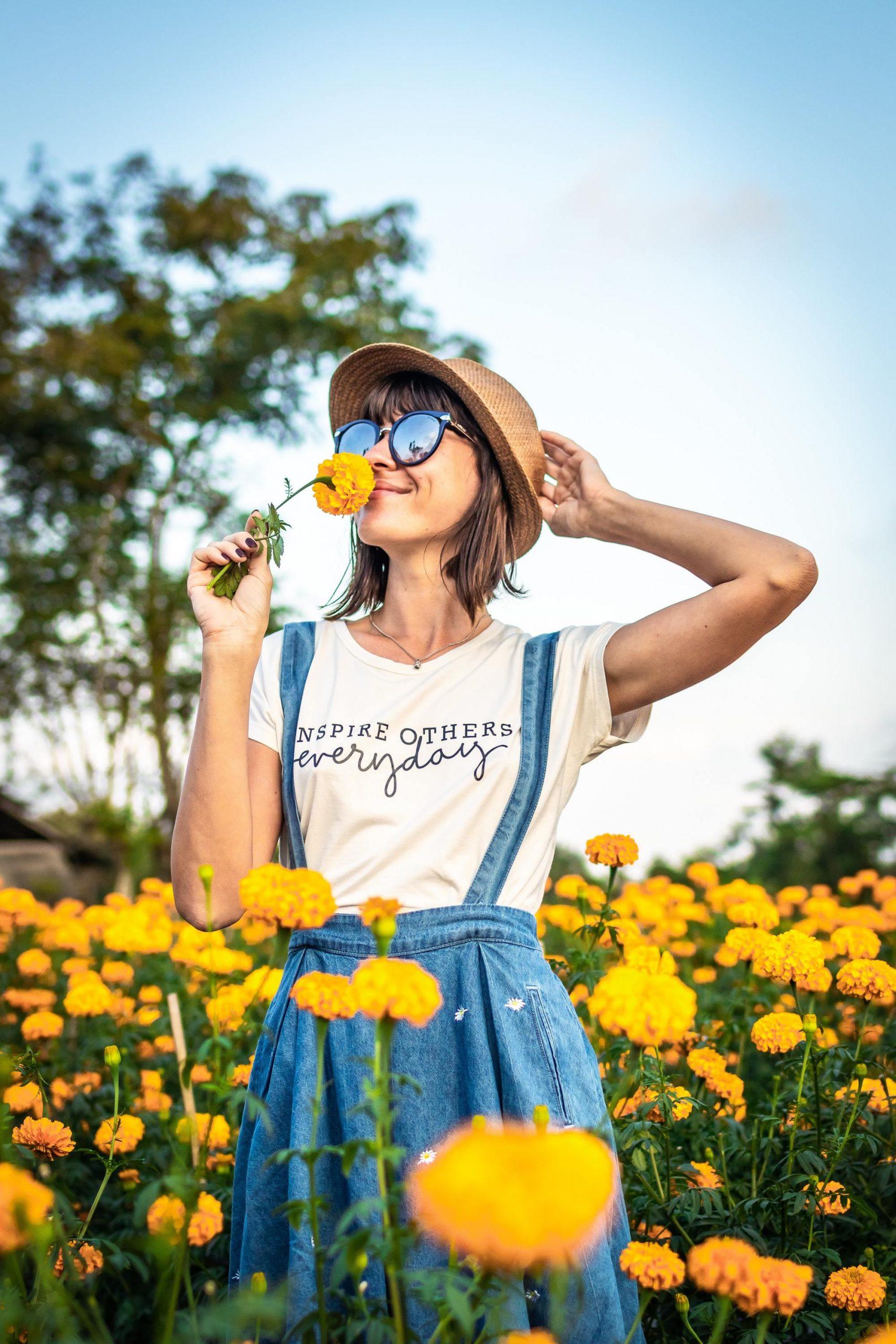 healthy woman in sunflower field